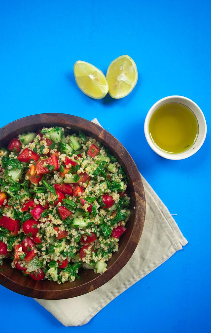 Mediterranean summer salad--nutritious salad filled with an array of vegetables, herbs, and tossed with a super simple dressing! |www.cookeatlaugh.com