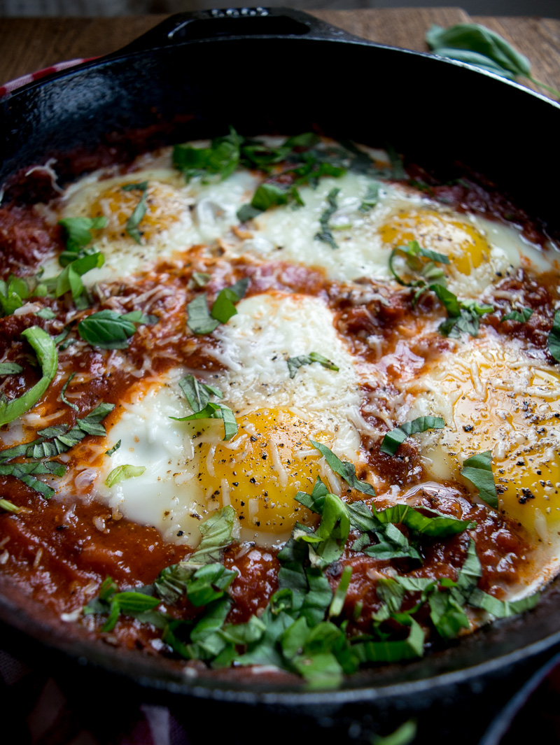Eggs in purgatory-eggs are poached in a lip-smacking fiery tomato sauce that is meant to sopped up with a hunky slice of bread. |www.cookeatlaugh.com
