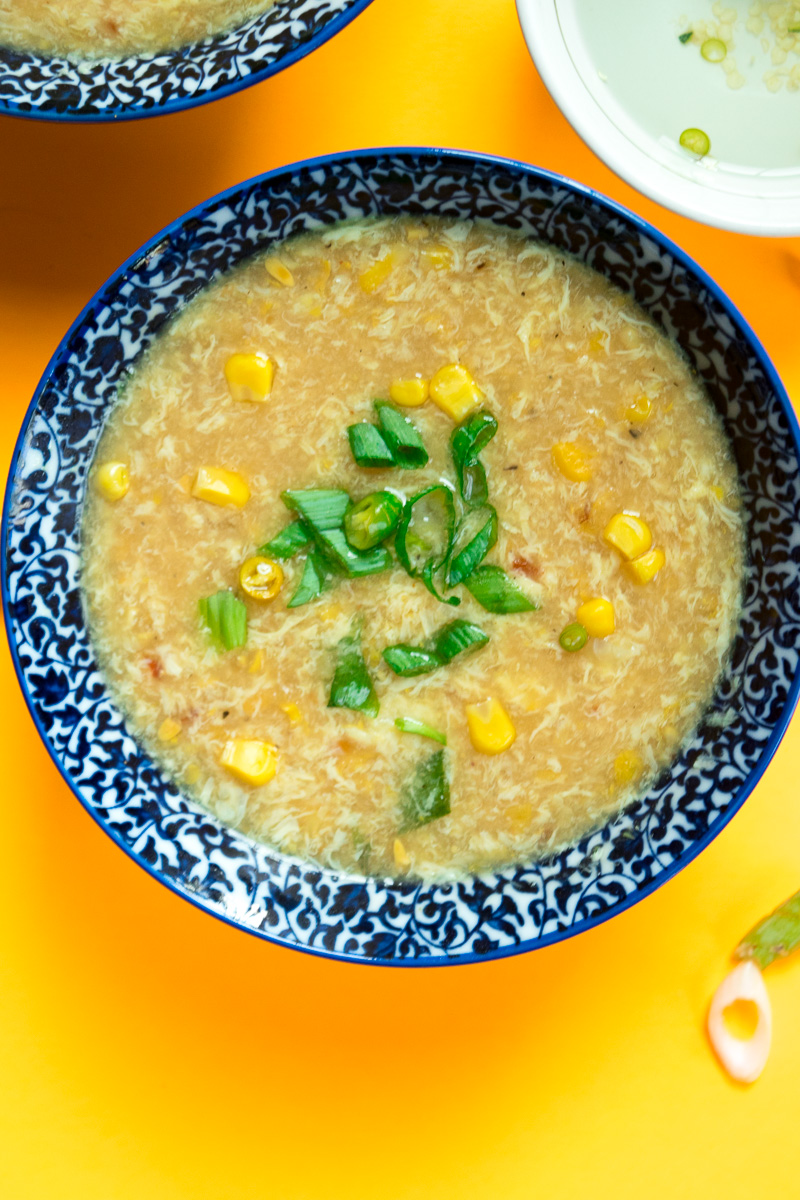 Indo chinese sweet corn soup with chili vinegar--a popular Indo Chinese soup which takes 20 minutes, one pot, and uses just a handful of ingredients.|www.cookeatlaugh.com