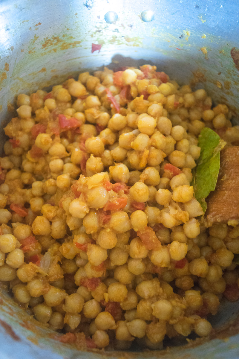 One pot chickpea stew (Indian Chana curry)--cooked in a rich tomato onion gravy that is spiced with cumin, coriander, turmeric, garam masala, and chili powder. |www.cookeatlaugh.com