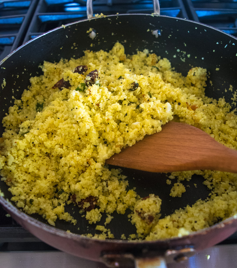 Quick 10-minute lemon cauliflower rice--Riced cauliflower tossed with aromatic Indian spices, so good you won't miss the rice! |www.cookeatlaugh.com