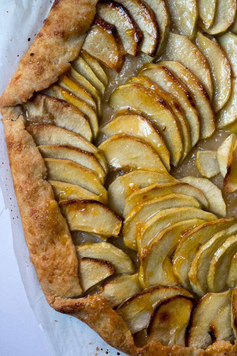 Rustic french style apple tart--a crispy crust, lightly sweetened apples, and butter. Super impressive, super delicious, and super easy to make. |www.cookeatlaugh.com