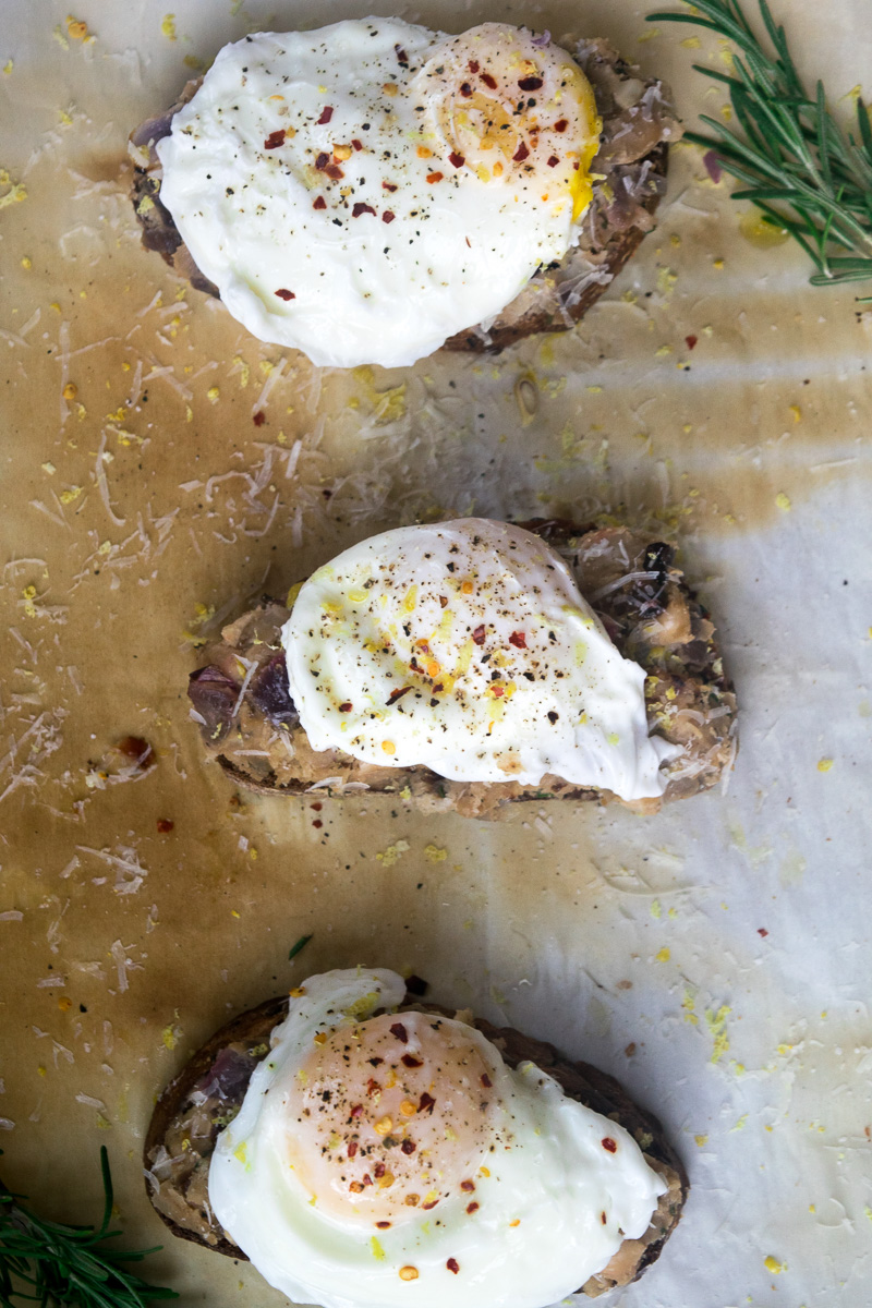 Smashed beans on toast with poached egg--Canned white beans tossed with spices, smashed on toast, topped with a perfeclty poached egg. |www.cookeatlaugh.com
