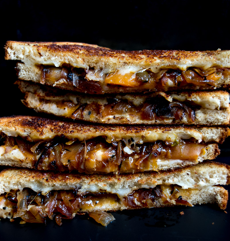 The ultimate sweet & savory grilled cheese--tangy sweet peach chutney and carmalized onions pairs perfectly with the ooey gooey melted cheese! |www.cookeatlaugh.com
