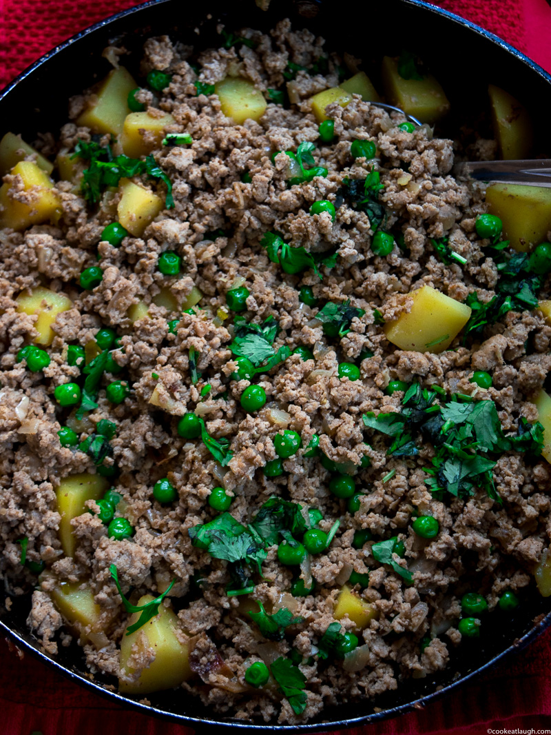 Aloo keema--a dish made of spiced and minced turkey, simmered with potatoes and peas! |www.cookeatlaugh.com