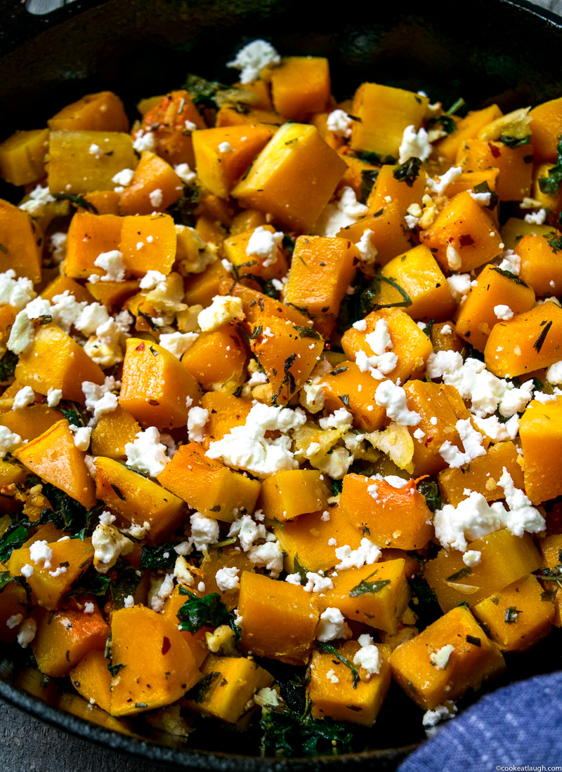 Sautéed Butternut squash with kale and feta--a lovely flavorful side dish for any of the upcoming holiday dinners! |www.cookeatlaugh.com