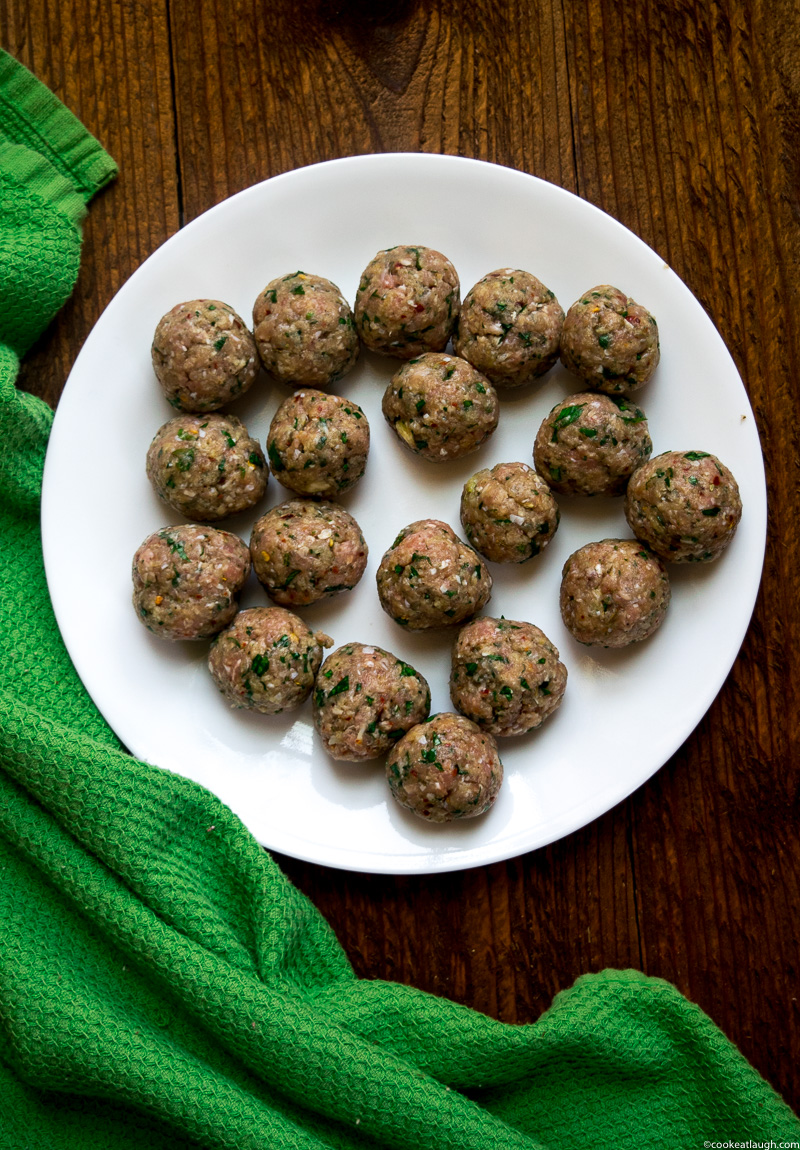 Spicy turkey meatballs in tomato sauce--it takes roughly 30 minutes to make and are super flavorful and juicy simmered in a simple tomato sauce!  www.cookeatlaugh.com -1