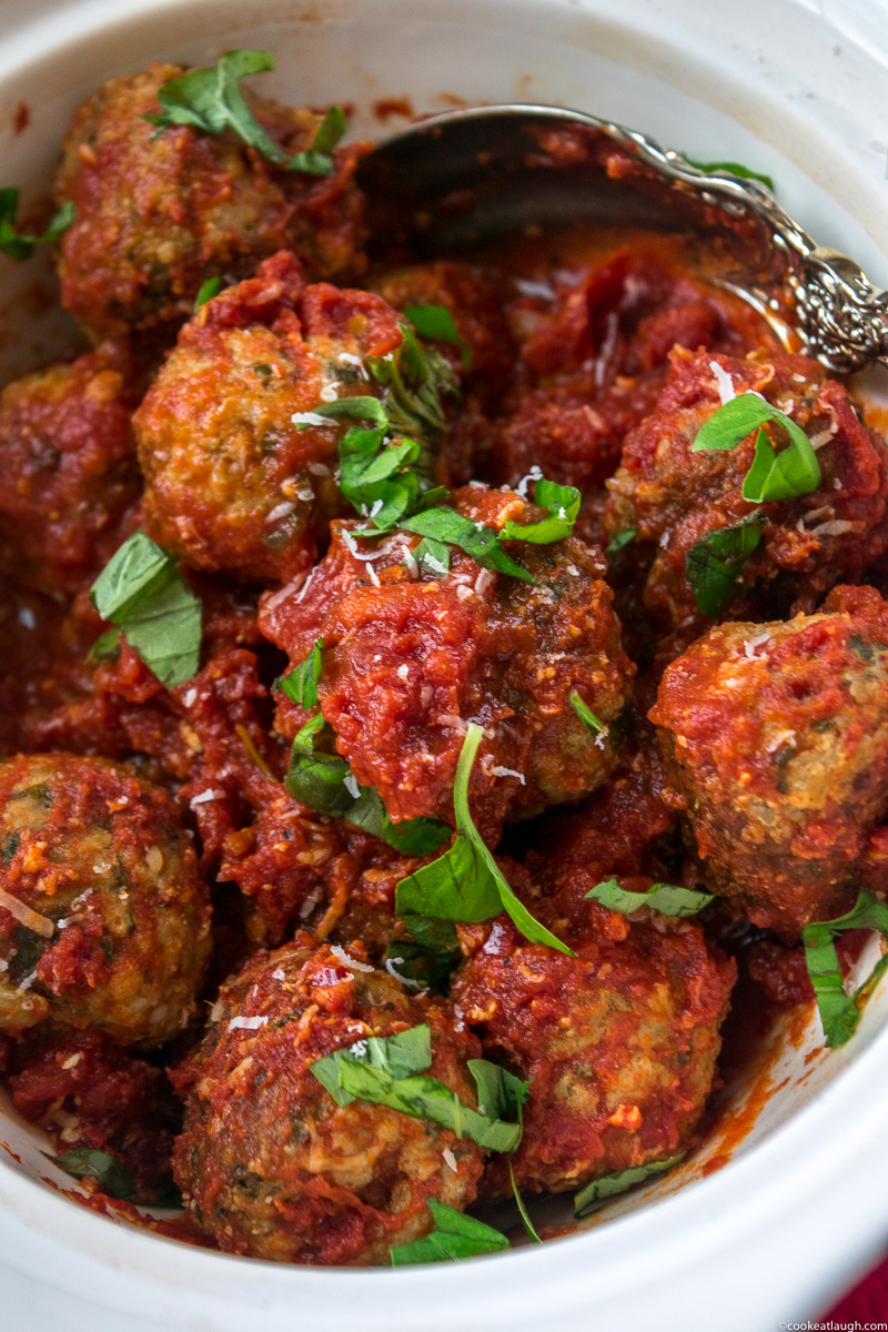 Spicy turkey meatballs in tomato sauce--it takes roughly 30 minutes to make and are super flavorful and juicy simmered in a simple tomato sauce!  www.cookeatlaugh.com -11