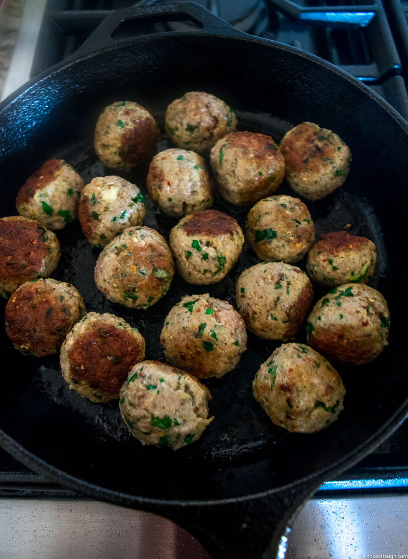 Spicy turkey meatballs in tomato sauce--it takes roughly 30 minutes to make and are super flavorful and juicy simmered in a simple tomato sauce!  www.cookeatlaugh.com -2