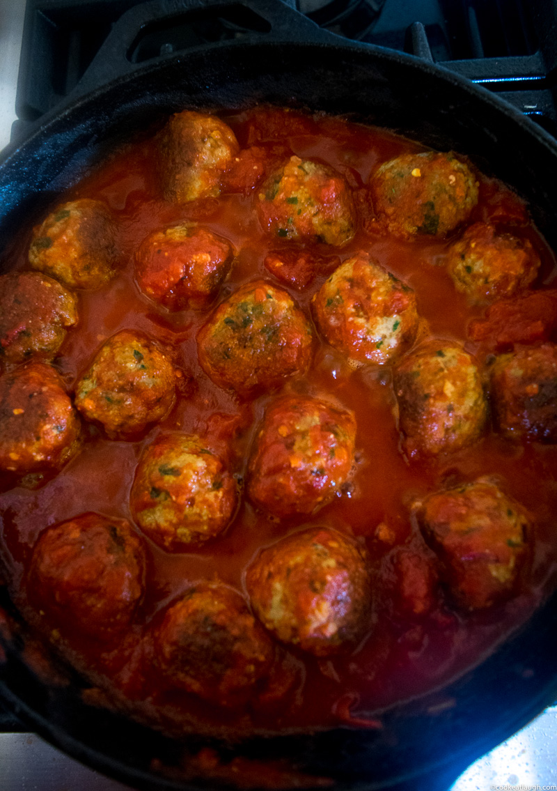 Spicy turkey meatballs in tomato sauce--it takes roughly 30 minutes to make and are super flavorful and juicy simmered in a simple tomato sauce!  www.cookeatlaugh.com -3