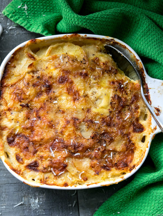 Simple and Easy potato au gratin— is a French style potato dish that is rich, creamy, and delicious. A perfect make ahead side for the holidays. |www.cookeatlaugh.com--4