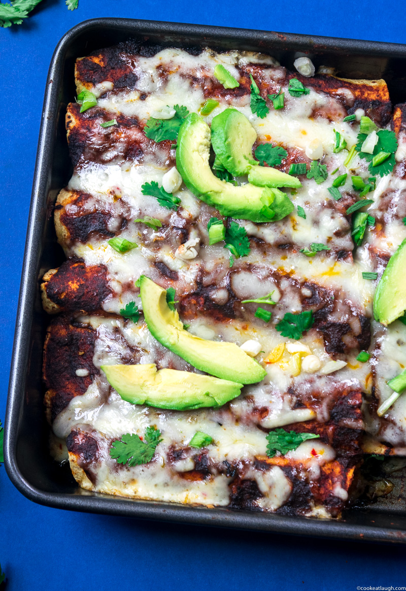 Deliciously Easy Chicken enchiladas! My favorite chicken enchilada recipe made with corn tortillas, spiced shredded chicken, cheese, and homemade red sauce. Seriously delicious! www.cookeatlaugh.com---14