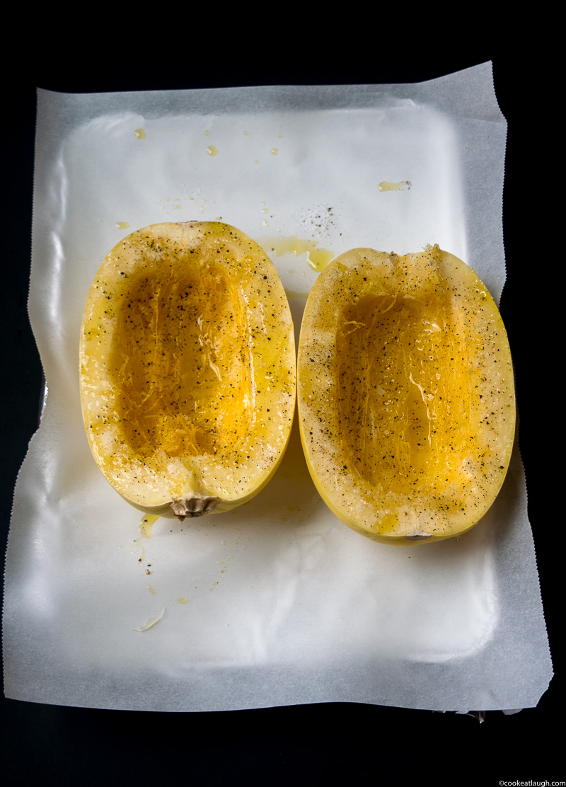 Lemon garlic spaghetti squash! is an incredibly flavorful dish, that will satisfy your carb cravings. It's gluten-free, vegan, and low-carb.  www.cookeatlaugh.com-1